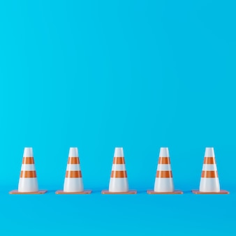 Leitkegel auf blauem hintergrund. minimale konzeptionelle idee. 3d-rendering