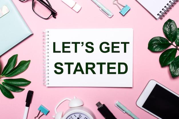 Let is get started ist in ein weißes notizbuch geschrieben