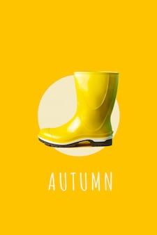 Leuchtend gelber gummistiefel gegen die gleiche farbe.
