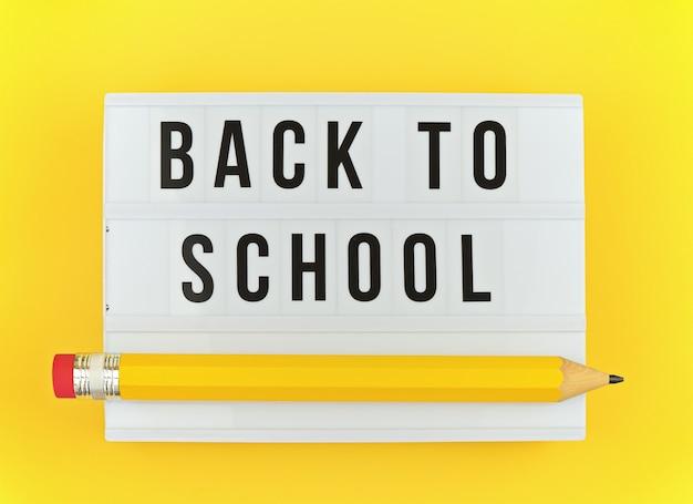 Leuchtkasten mit back to school-text und großem lustigem stift auf gelb