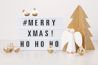 Leuchtkasten mit dem Text Frohe Weihnachten