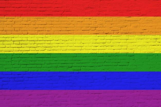 Lgbt-flagge gemalt auf backsteinmauer.