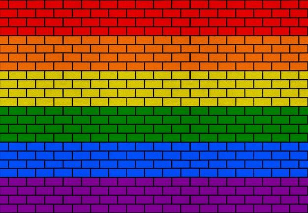 Lgbt-regenbogenflaggenfarbziegelsteinblockstapelwohnwandbeschaffenheitsdesignhintergrund.