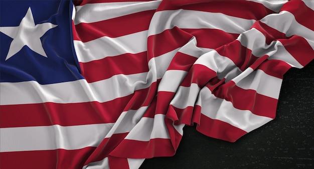 Liberia-flagge, die auf dunklem hintergrund verstreut ist 3d render
