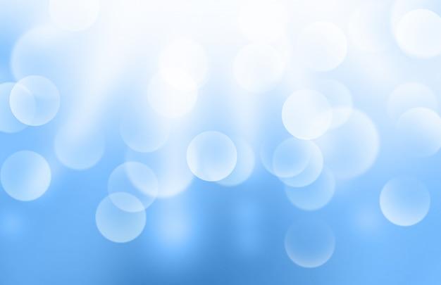 Lichter oder unscharfes bokeh auf blauem steigungshintergrund