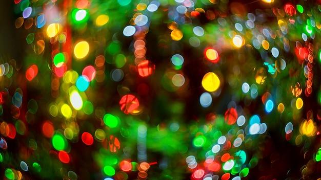 Lichter verschwommener bokeh-hintergrund von der weihnachtsnachtparty für ihr design vintage- oder retro-farbe...