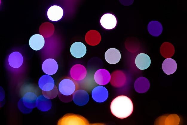 Lichter verwischten bokeh hintergrund von der nachtpartei für ihr design