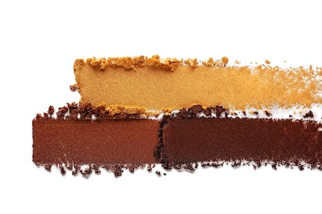 Lidschatten schimmernd matt mehrfarbig gelb goldbraun nude palette textur hintergrund weiß isoliert