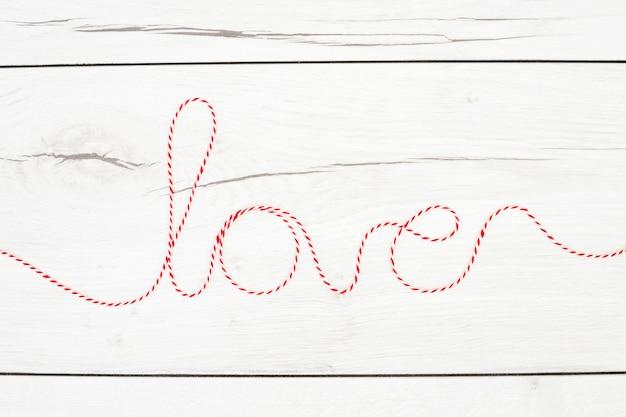 Liebe inschrift des fadens
