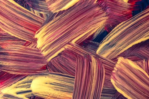 Lila und goldene farben des abstrakten kunsthintergrundes. aquarellmalerei auf leinwand mit lila strichen und spritzern. acrylbild auf papier mit pinselstrichmuster. textur-hintergrund.