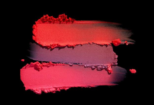 Lippenstift matte textur verschmiert schwarzen isolierten hintergrund