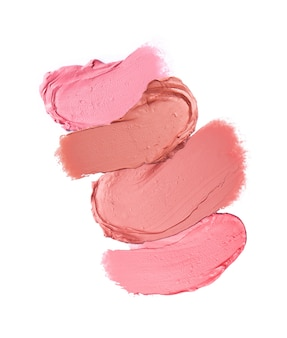 Lippenstift pinselstriche in verschiedenen schattierungen isoliert auf weiß