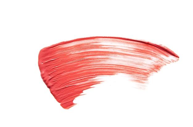 Lippenstiftstrich lokalisiert auf weißem hintergrund das konzept der mode- und schönheitsindustrie bild