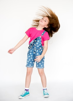 Little girl confidence selbstachtung haar whip head banging studio portrait