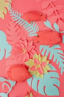 Living coral konzept. fischspielzeug eingestellt und origami papercraft blumen