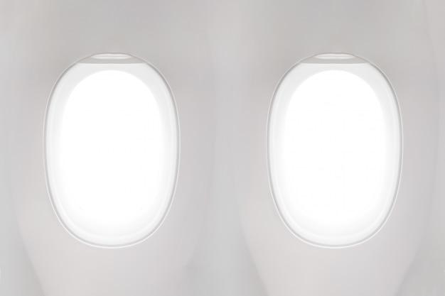 Lokalisiertes flugzeugfenster von der kundensitzansicht über weißen hintergrund