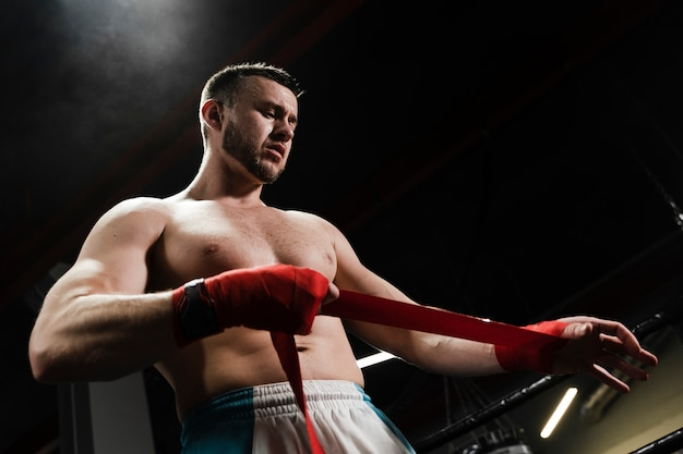 Low angle man training im boxring