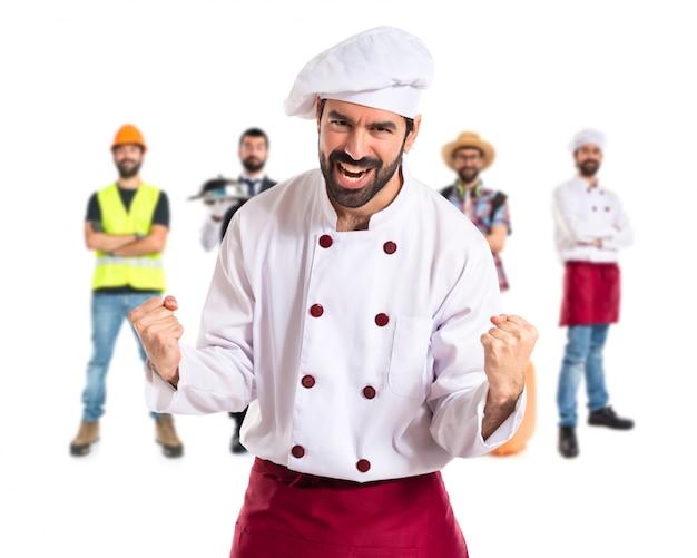 Lucky chef über isolierten weißen hintergrund
