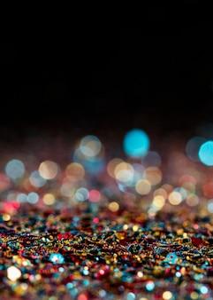 Lumineszierender mehrfarbiger glitzer mit kopierraum