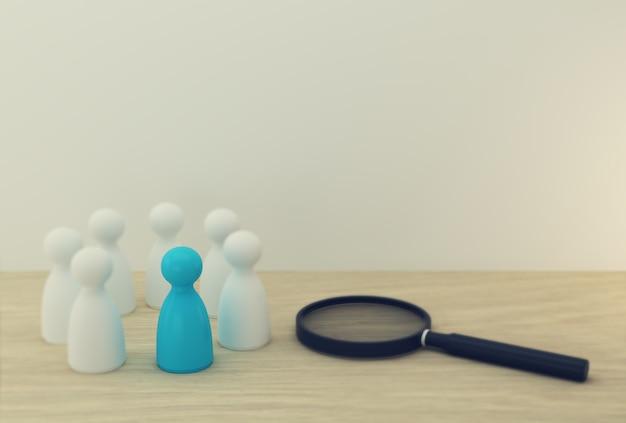 Lupe mit blauen menschen modell hervorragend aus der masse heraus. team für personal- und talentmanagement und geschäftsaufbau von mitarbeitern in der organisation