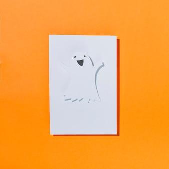 Lustiger halloween-geist auf blatt papier