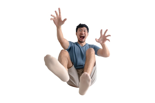 Lustiger voller körper des schockierten asiatischen mannes, der weggeblasen wird