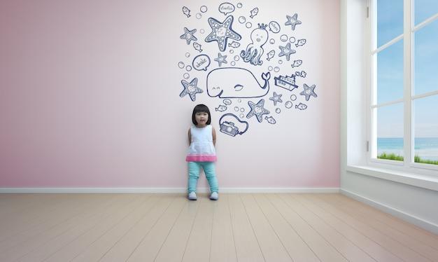Lustiges asiatisches kind, das im rosa raum des strandhauses spielt.