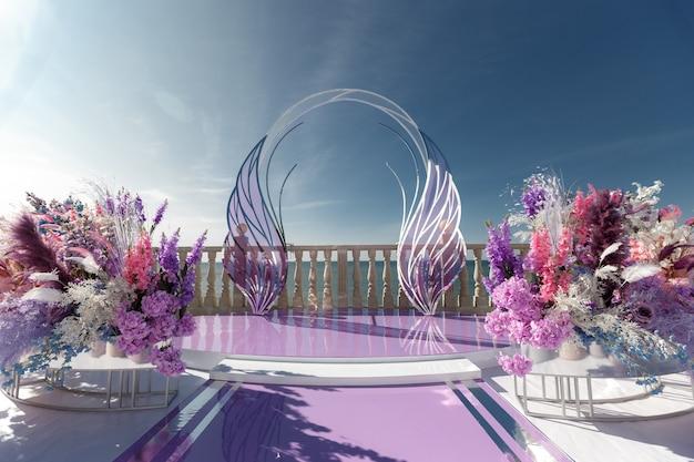 Luxuriöse hochzeitszeremonie im modernen stil auf dem hintergrund des ozeans. schöne feier