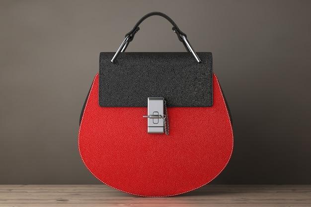 Luxuriöse rote leder-frauen-taschen auf einem holztisch. 3d-rendering