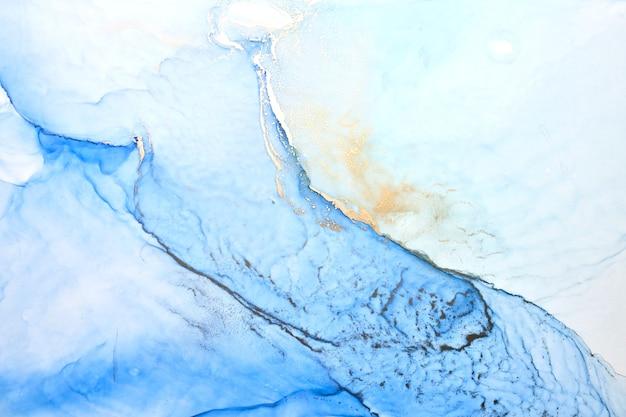 Luxuriöser abstrakter hintergrund in alkoholtintentechnik, indigoblaue goldflüssigkeitsmalerei, verstreute acrylkleckse und wirbelnde flecken, bedruckte materialien