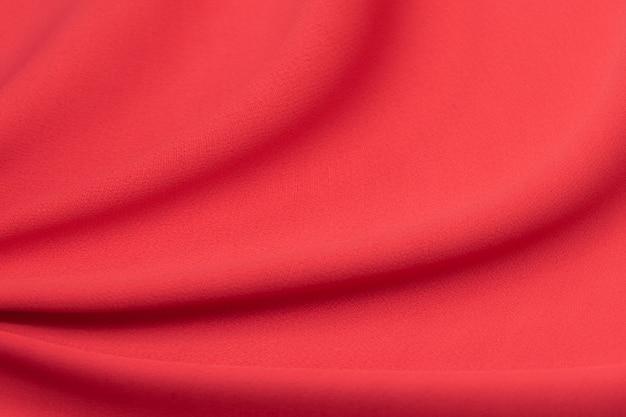 Luxuriöser roter viskose- oder seidenstoff. hintergrund und muster.