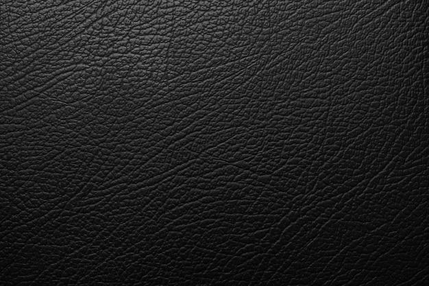 Luxuriöser schwarzer ledertextur-oberflächenhintergrund