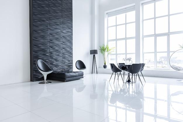 Luxuriöses futuristisches, trendiges, modernes interieur in kontrastierenden schwarz-weiß-farben mit interessanten modischen schwarzen möbeln und dekorierter wand