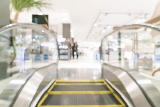 Luxus-ladengeschäft der abstrakten unschärfe im einkaufszentrum