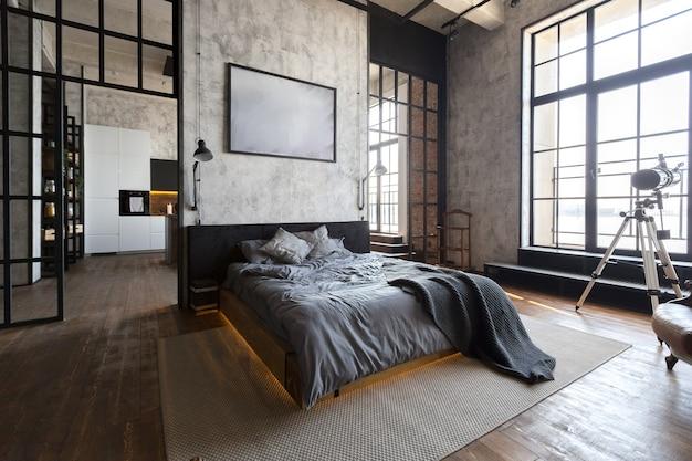 Luxusapartment im loftstil in dunklen farben. stilvolles modernes schlafzimmer