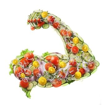 Macht frischer salat in form einer muskulösen hand eines mannes isoliert auf weißem hintergrund