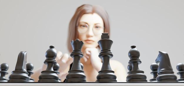 Mädchen spielt schach auf verschwommen mit schwarzen figuren im fokus