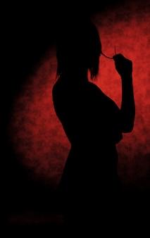 Mädchenschattenbilder auf dem schemel auf rot