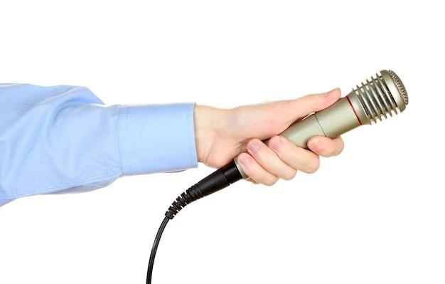 Männliche hand mit mikrofon isoliert auf weiß