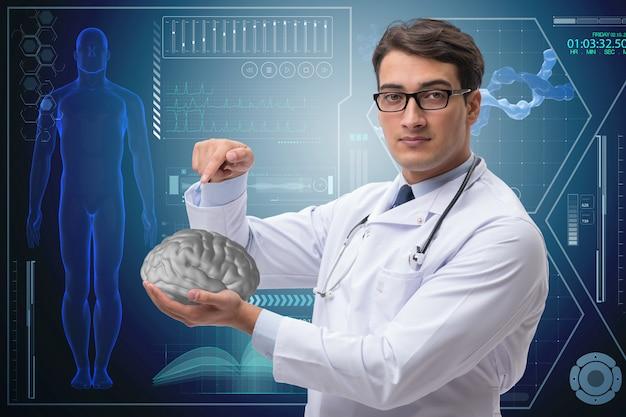 Männlicher doktor mit dem gehirn im medizinischen konzept