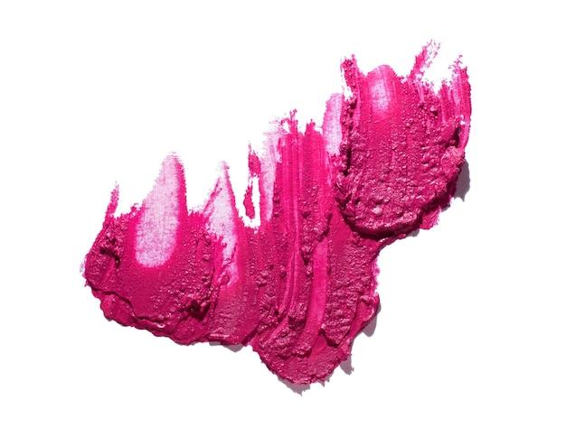 Magenta rosa lippenstiftmuster lokalisiert auf weißem hintergrund