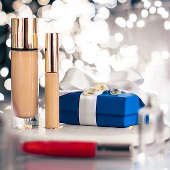Make-up foundation base concealer und blaue geschenkbox