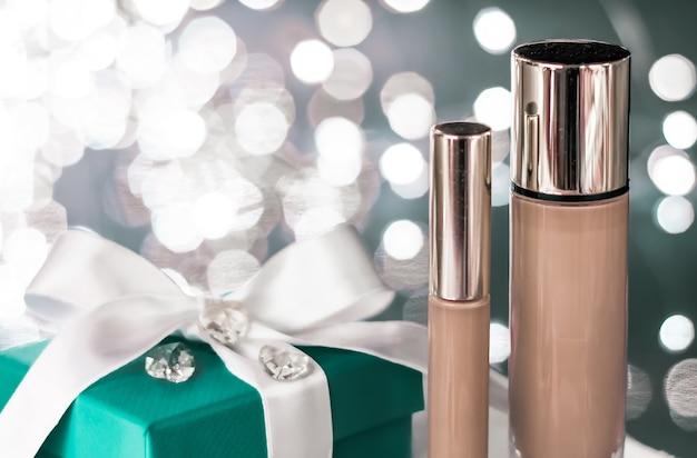 Make-up foundation base, concealer und grüne geschenkbox