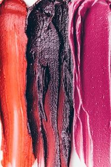 Make-up-hintergrund. schönheitskunst mode. verschmierte strukturierte lippenstiftproben.