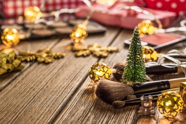 Make-up im weihnachtszeit-hintergrundkonzept.
