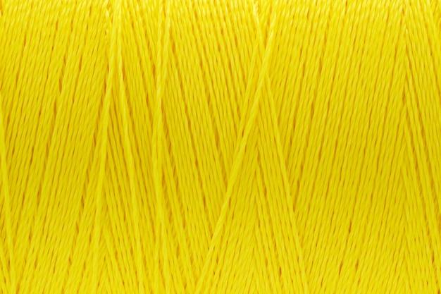 Makrobild des fadenbeschaffenheitsgelb-farbhintergrundes
