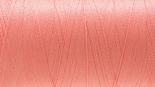 Makrobild des fadenbeschaffenheitsrosafarbhintergrundes
