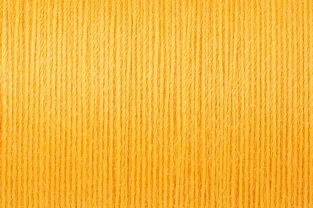 Makrobild des gelben threadbeschaffenheitshintergrundes