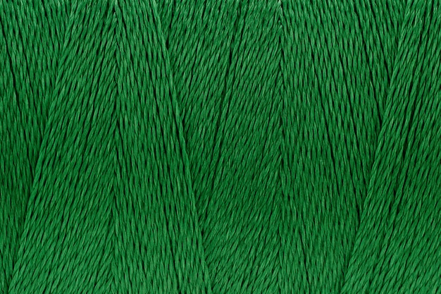 Makrobild des hintergrundes der grünen beschaffenheit der fadenbeschaffenheit