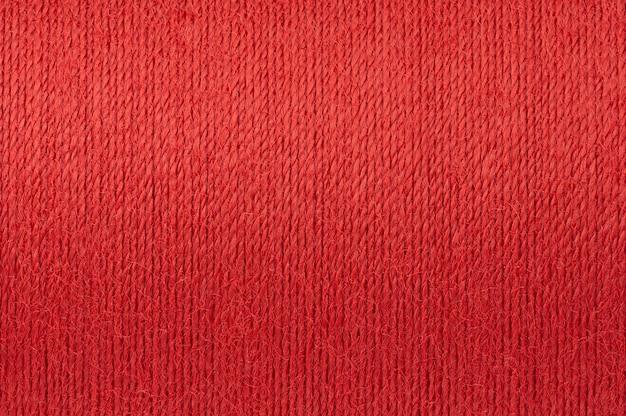 Makrobild des roten threadbeschaffenheitshintergrundes